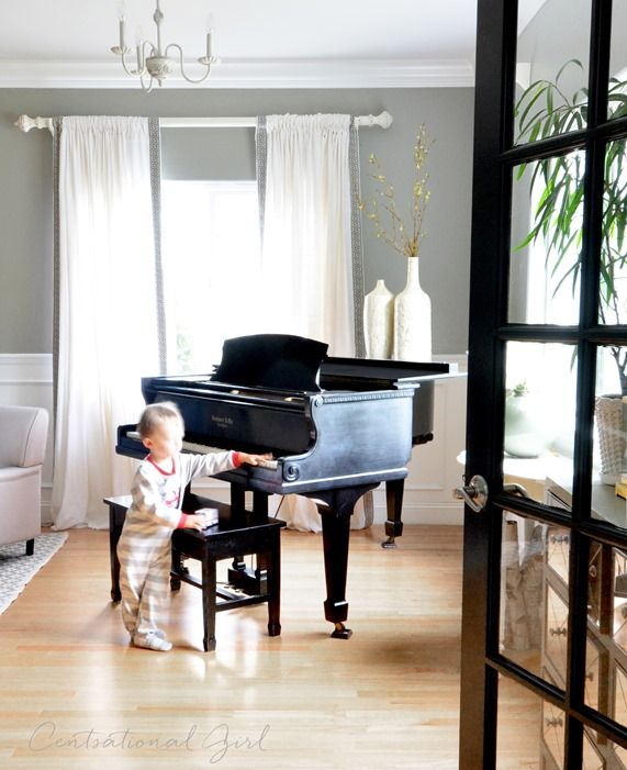 """""""Never off limits as long as it is treated gently""""  Love this.  black baby grand piano living room"""