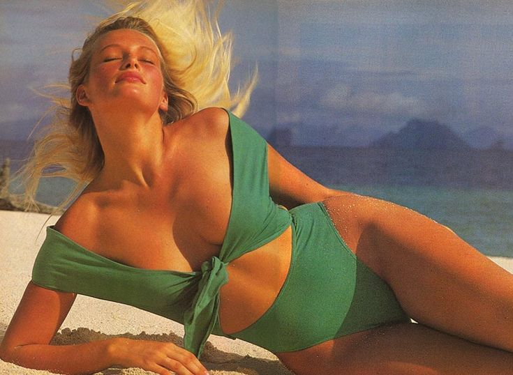 1988 Sports Illustrated Swimsuit. Photographed by Mark Hispard.  Estelle Lefebure is swept away by the beauty of the Phi Phi Islands, in Phang Nga Bay, in a Giorgio di Sant' Angelo creation ($400).: