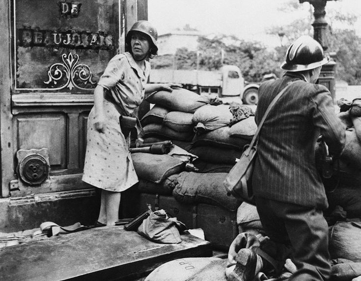 France. A French man and woman fight with captured German weapons as both civilians and members of the French Forces of the Interior took the fight to the Germans, in Paris in August of 1944, prior to the surrender of German forces and the Liberation of Paris on August 25. You don't only have to thank the soldiers who liberate cities like Paris but also the civilians... ~