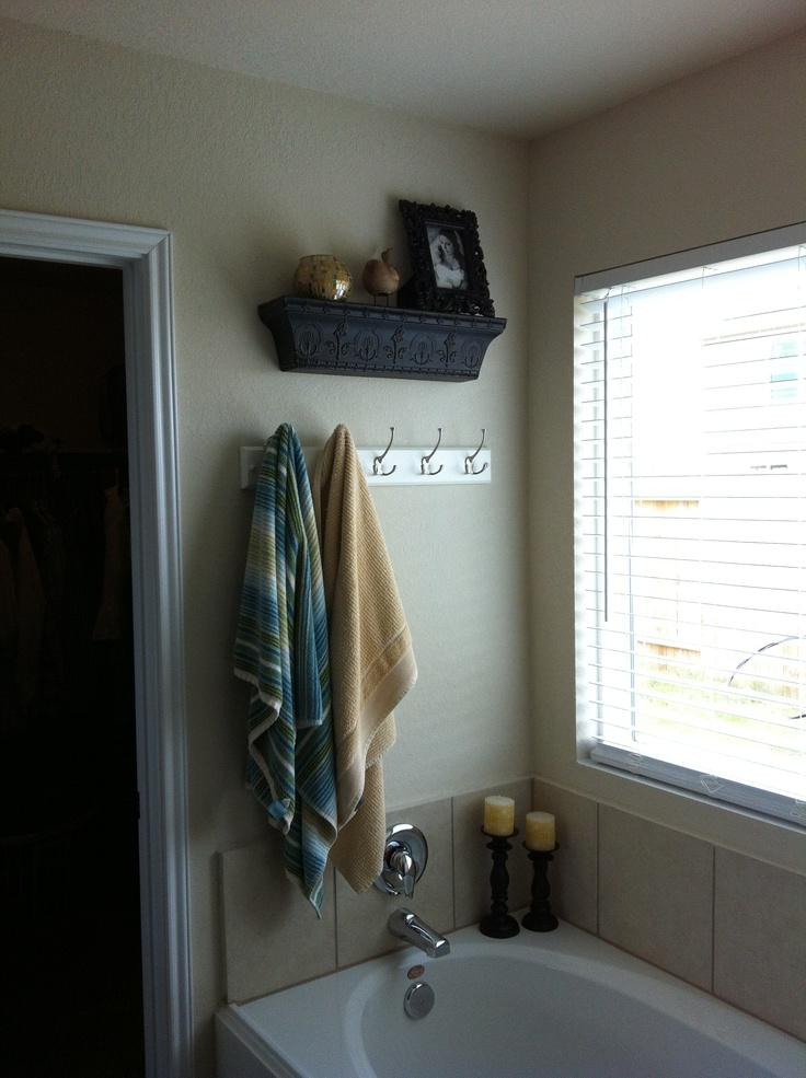 I kinda like the hook rack idea for towels. I wonder if I can find something a little nicer for over my garden tub.