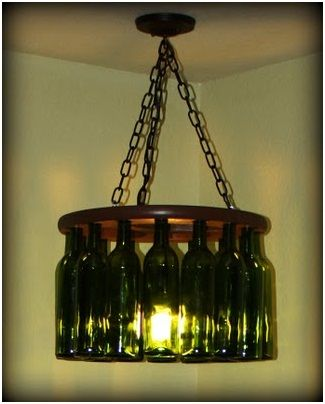 Wine Bottle Chandelier: Drill holes through a stool top, insert the necks of wine bottles and then use rotor clips to hold the bottles in place. Add a simple light kit in the center of the chandelier. When turned on, the light reflects through the wine bottles, creating a unique chandelier, and a wonderful conversation piece.