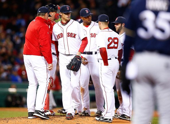 Clay Buchholz #11 of the Red Sox is pulled from the game by manager John Farrell against the Brewers during the game at Fenway on APR 05, 2014. Buchholz went 4.1 innings with 13H, 6R, 3K (72-54). Red Sox lost in the 11th inning 7-6.