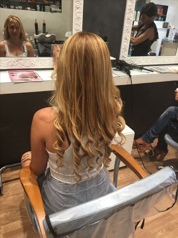 Curly long blond hair