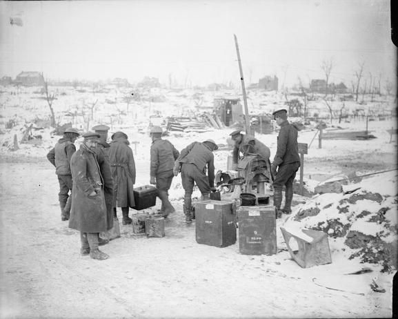 British soldiers filling tins and dixies at a watering point in the snow at Combles, 3 February 1917.