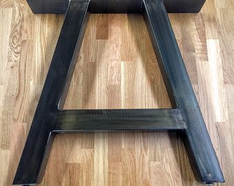 Metal A Frame Table Legs - 3 x 3 Steel Tubing  Listing is for 2 legs! Up for sale are handmade pairs of A Frame table/desk legs. They feature all welded 3 steel square tubing. The top base plate is 4 wide made from 1/4 thick steel plate and is drilled for mounting screws. At the bottom of the legs are threaded inserts with adjustable feet to level your table on an uneven floor. The finish is a blackened patina, a beautiful black marbled with auburn and browns. We seal the legs with a durable…