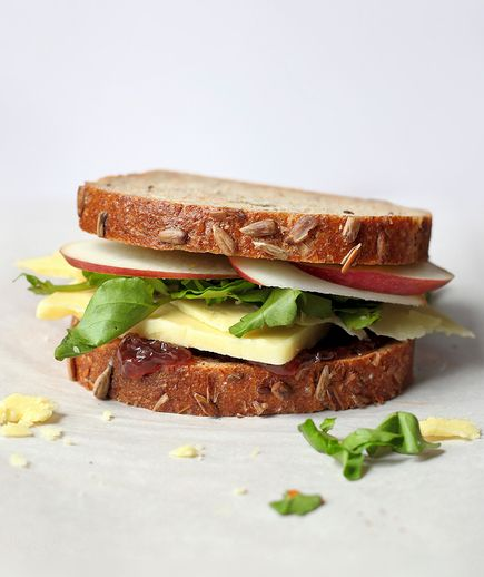 Chock full of savory onion jam, spicy mustard, crunchy apple, and creamy cheddar, this rustic sandwich translates the flavors of the iconic pub lunch into handheld form. Wash it down with iced tea—or, even better, a pint of ale.