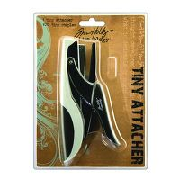 Tiny Attacher By Tim Holtz      Staples are .25 inch. (standard are .5 inch and mini are .375 inch) This Tiny Attacher is smaller than a standard stapler and even smaller than a mini stapler. Its unique design allows you to secure ribbons and other elements to your project with a simple squeeze.    Tiny attacher: a hand powered, clamping tool for fastening or affixing things together with miniature wire staples.  Tim Holtz Idea-ology Collection