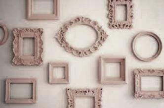the original blog pic of this showed pink frames! I changed it to suit my color scheme; reverse this(taupe wall, off-white frames) and this is what I'm doing around my 'Golden Spring' canvas on the main blank wall - with fewer frames, btw.