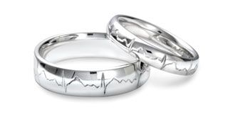 """ECG Ring: """"Your loved ones very own heartbeat rhythm is hand engraved by our award winning craftsmen. With the use of a small portable ECG monitor we take your heartbeat and hand engrave it perfectly onto one of his beautiful solid wedding bands.""""  How freakin' cool is that?!?"""