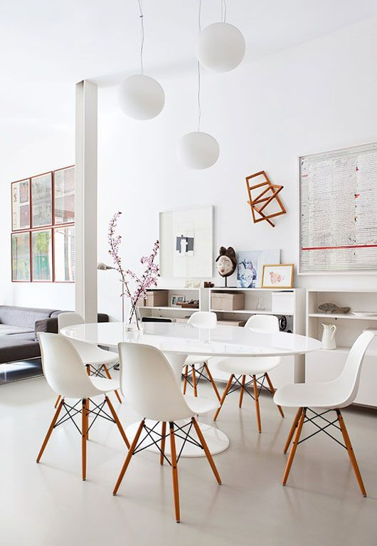 white eames and simple pendants. Love that wall sculpture, too.