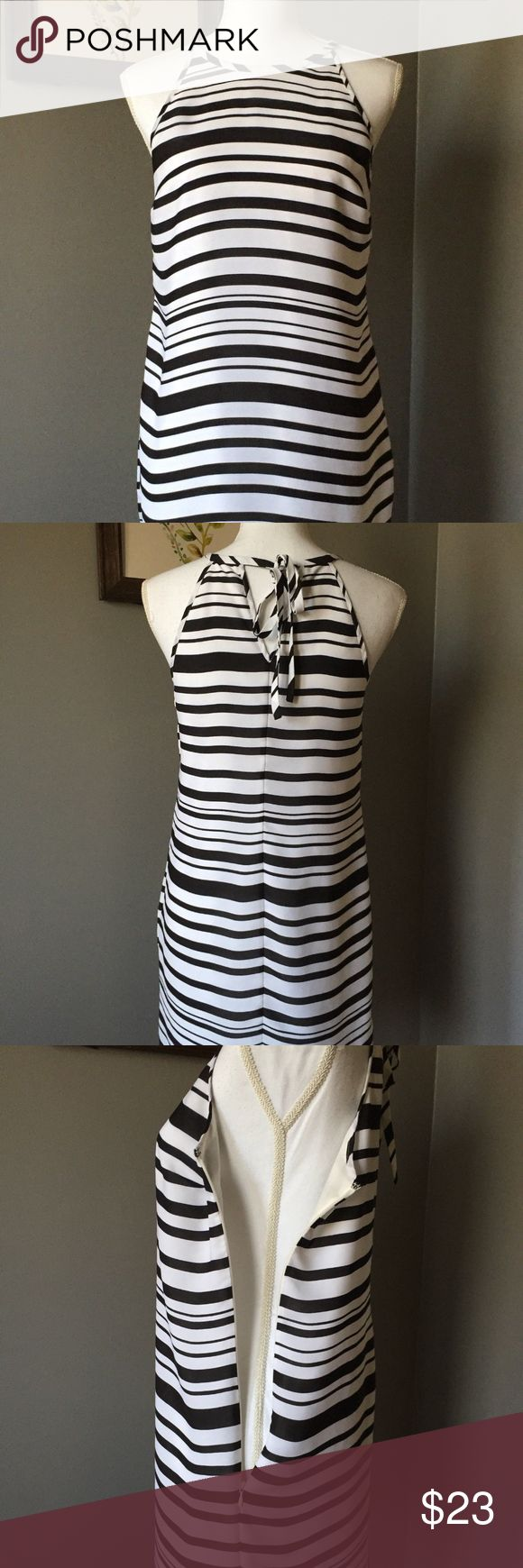 """Banana Republic 4 Black White Stripe Halter Dress Women's size 4 Banana Republic shift dress. Halter style neckline with a tie in the back. 100% Polyester. Black and white stripes. Lining is a cream color. Gently used, minimal signs of wear.   Approximate measurements (laid flat):  Armpit to armpit: 17"""" Length: 34"""" Banana Republic Dresses"""