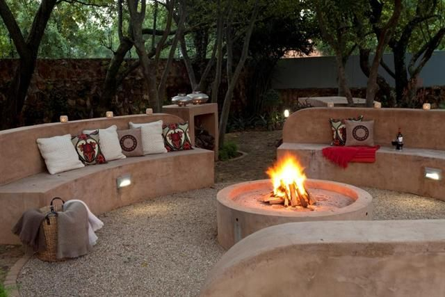 Garden and Home | Designing a stylish boma. White stinkwoods provide a leafy backdrop to this unusual boma designed by Neville Orsmond of Create a Landscape.