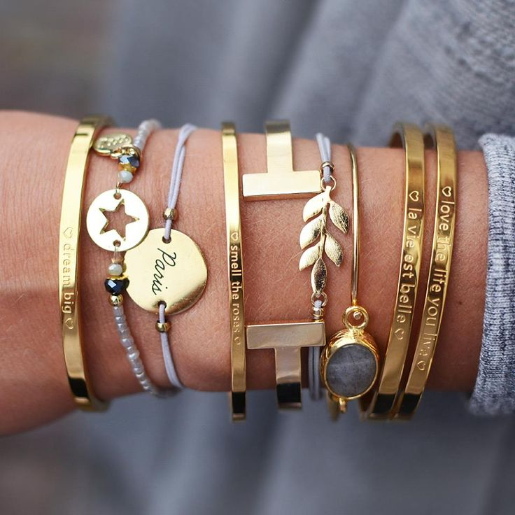 Grey and gold arm party by @myjewellery