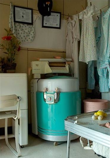 Laundry room with ringer washer.
