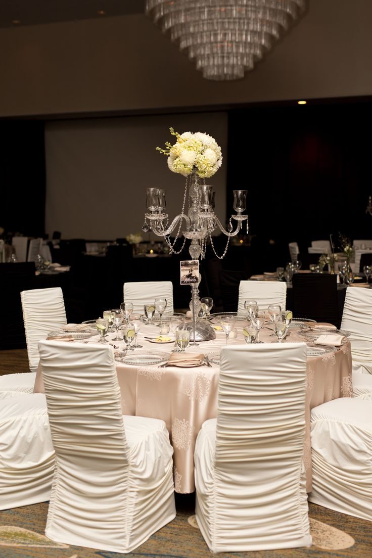 Tall Candelabra White Flower Centerpiece, Champagne Linens, Ivory Chair Covers Flowers: @facheflorals || Photo: @amarie_photo ||