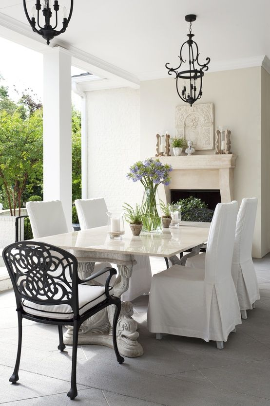 Outdoor table set. I would add dropped to the floor drapes.