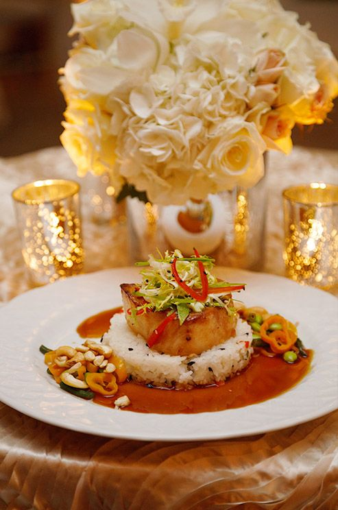 Wild honey and soy marinated Chilean sea bass and spicy Chinese long beans with cashews top jasmine and black forbidden rice.
