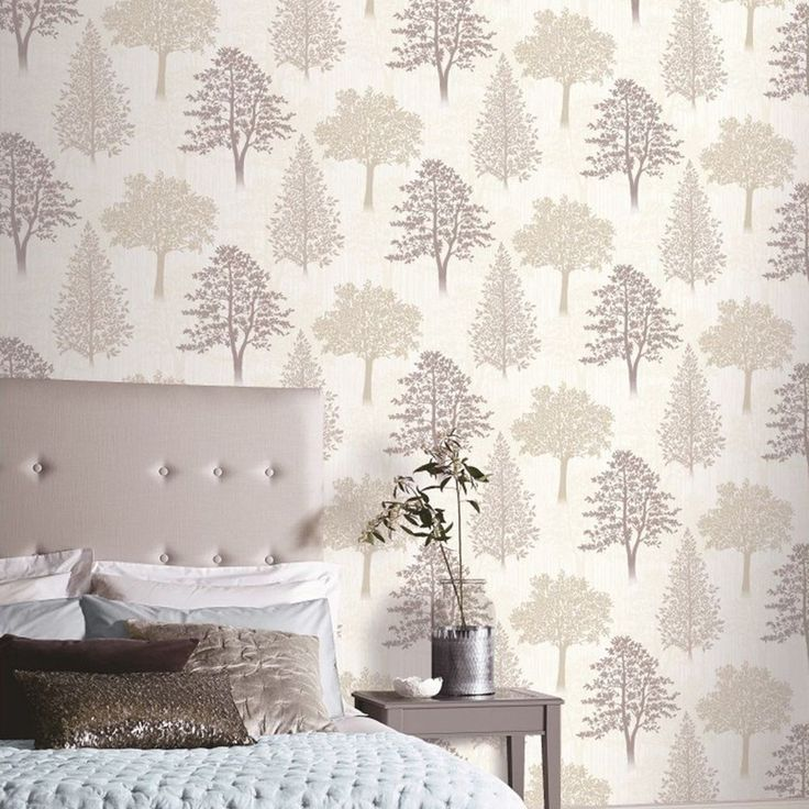 Diamond Tree Wallpaper Natural Arthouse 259002  This beautiful Tree Wallpaper will add a stylish finishing touch to any room. The wallpaper features a collection of stunning tree silhouettes in tones of beige and taupe, set on a soft cream background patterned with subtle pale cream tree silhouettes. The design is printed onto high quality paper that has a textured stripe effect and is infused with shimmering glitter particles. Easy to apply, this wallpaper will look great when used to…