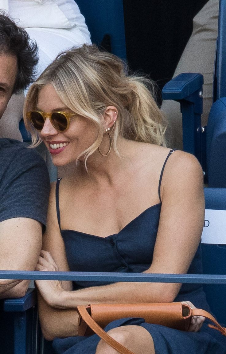 Sienna Miller upgraded tennis's official hairstyle into a thing of date-ready elegance.