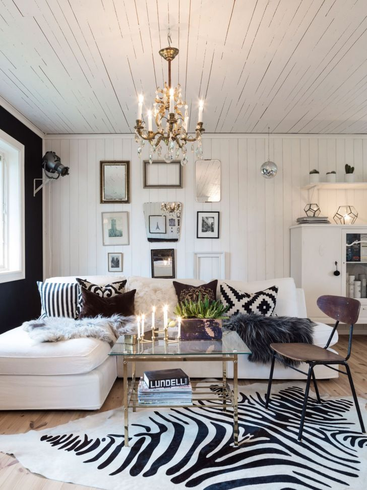 Bold patterns. - THERE IS SO MUCH I LOVE ABOUT THIS ROOM! - THE CHANDELIER, THE ZEBRA SKIN RUG, THE ART WALL...........JUST AN AWESOME AND VERY CHARACTERFUL ROOM!! - GORGEOUS!#️⃣