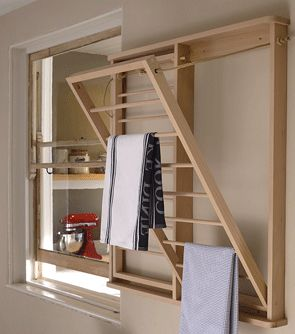 Our beadboard drying rack attached to the wall in the utility room. The panels fold down to provide drying space for even the larger family.