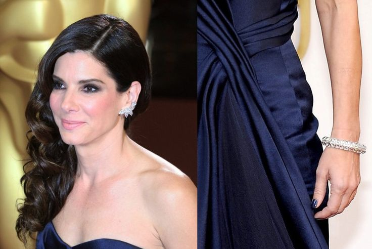 Sandra Bullock opted for jewelry by Lorraine Schwartz, wearing a pair of platinum and diamond cluster earrings ($1.8 million) and a diamond bracelet ($6.4 million). Together, the jewels are worth a total of $8.2 million.  #oscars #oscarjewelry #oscarfashion #sandrabullock #oscars2015