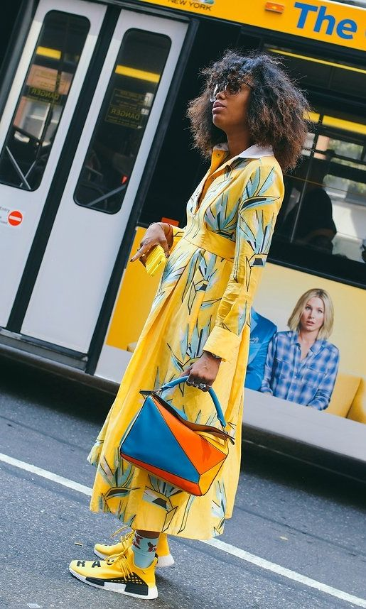 Bright colors, bold prints, and of course, a Loewe bag. On the street at New York Fashion Week. Photographed by Phil Oh.
