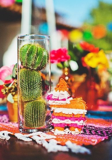 Arrange cacti in a hurricane globe for a festive, affordable centerpiece.