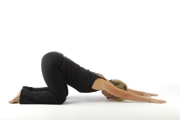 This pose is a cross between Child's Pose and Downward Facing Dog. It helps both to open your chest area and to stretch the neck and shoulders area, re-aligning us after long periods of slouching while sitting or standing. Like Child's Pose, start by kneeling. Lean forward and stretch your arms along the floor, but push your hips toward the ceiling. Think of forming a triangle with your torso, thighs, and the floor.
