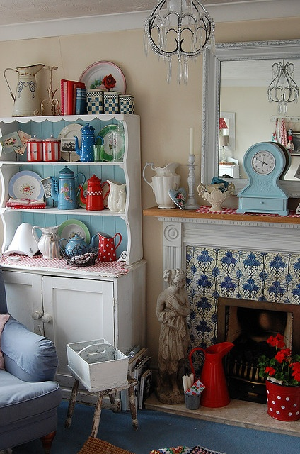 Love using the plates as decoration idea, I need to start collecting vintage miss match tea sets