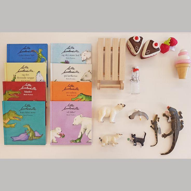 Sprogkuffert til dialogisk læsning af bøgerne om Lille Krokodille. Bøger, spil, legetøj, sange og remser samt vejledning med masser af forslag til aktiviteter til de enkelte bøger og tværgående temaer som dyr,  venskab, årstider og følelser.