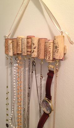 LOVE this idea! maybe mounted on a piece of birch branch. Wine Cork Necklace Rack by WhatShipsAreBuiltFor on Etsy