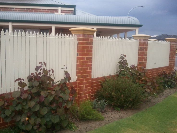 brick and picket fence