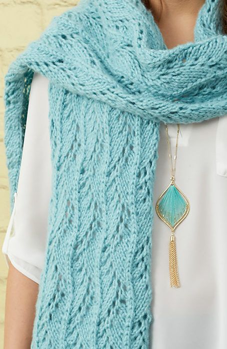 Free Knitting Pattern for Stunning Lace Scarf - Lace pattern in 16 row repeat flows the length of this scarf. Scarf Measures 12″ wide x 75″ long. Designed by Lisa Gentry for Red Heart