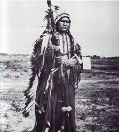 An old photograph of Powder Face In War Regalia - Arapaho Chief.