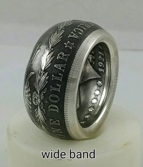 This is a 90% silver Morgan Silver Dollar coin ring. Sizes from 7-16 . This is a large coin that makes a very impressive ring. Your choice of polished ,light patina, or dark patina finish. There is a 1-2 week lead time on this custom made to order ring. The main picture is a narrow band,