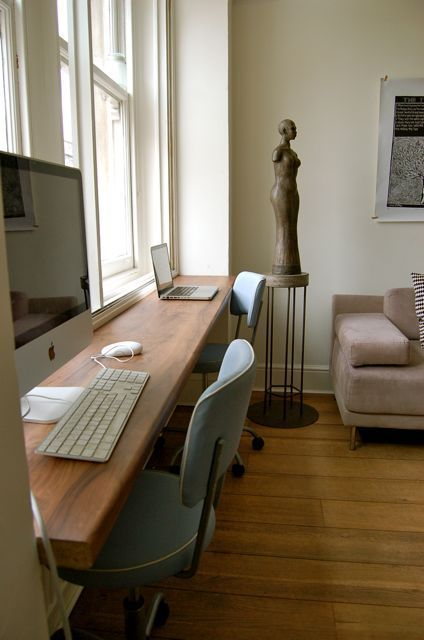 Sarah really likes this, as its a long space and can fit both of us when we work from home - plus its looking onto windows