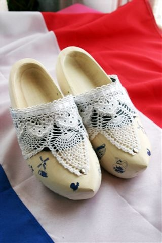 We have a lot of pairs of decorative klompen (wooden shoes) between us. They would make nice centerpieces, filled with tulips, or maybe chocolate kisses.