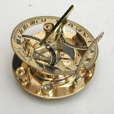 A solid brass sundial compass. A Precision sundial for accurate time measurements using the sun.