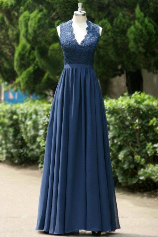 Navy lace and chiffon bridesmaid dress features scalloped v neck for the sleeveless bodice, long chiffon skirt drapes with pleated style whilst ribbon attached at natural waist, keyhole open back is finished.