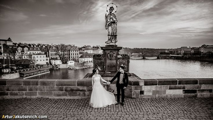 Together with Lin and Angela professional wedding photographer in Prague send two days taking lovely engagement photos with picturesque views of Czech capital and brides' emotions.