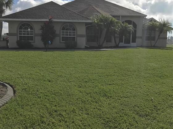 This impressive custom built pool home adds great fun to entertaining family and friends. Open floor plan with catheral ceilings three bedrooms all privately located. The master is very large with his and her walk-in closets and glass doors leading out to the pool. A rear screened porch for morning coffee to start your day viewing wildlife and early golfers. The garage houses two cars and a golf cart and has a skeeter beater screen installed. Interior of garage is very nicely finished and…