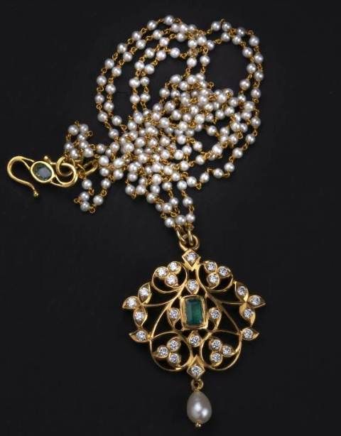 Traditional south Indian diamond and emerald pendant handcrafted in 22k gold.