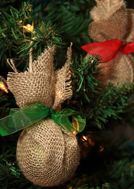 Upcycled Christmas Ornaments. Save money and DIY your burlap ornaments! Wrap the colored glass ornaments that you already have with burlap and tie with a colored ribbon!