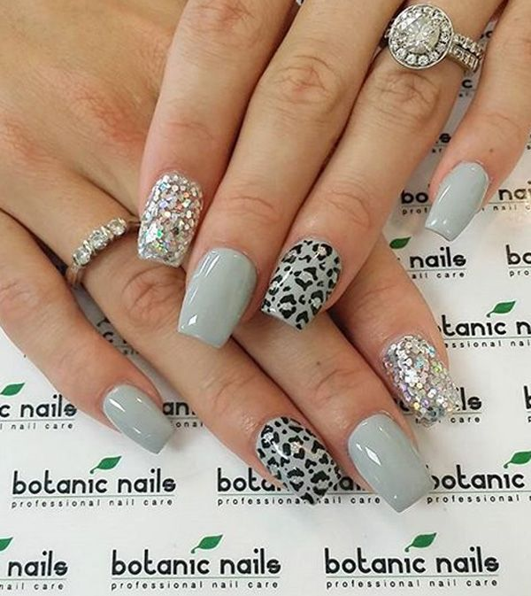 Gray themed leopard nail art design. Subtle, very laid back and cool looking design. The embellishments added on top of the layers of nail polish also proved as a great accessory to the design.