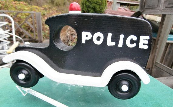 This one is modeled after the old police cars. Help,call a paddy wagon, Its purpose was to transport bad guys to jail, Your child will have lots of fun being the good guy hauling the bad guys off to the slammer---after they have been arrested, of course, It is about 10 inches long by 6