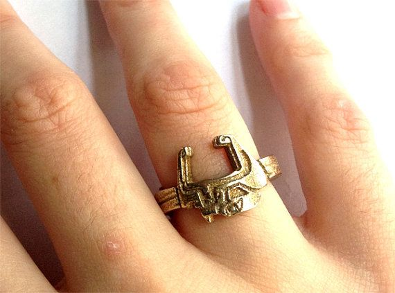 The Legend of Zelda: Twilight Princess Midna's Mask ring. And it has wolves on the back side!