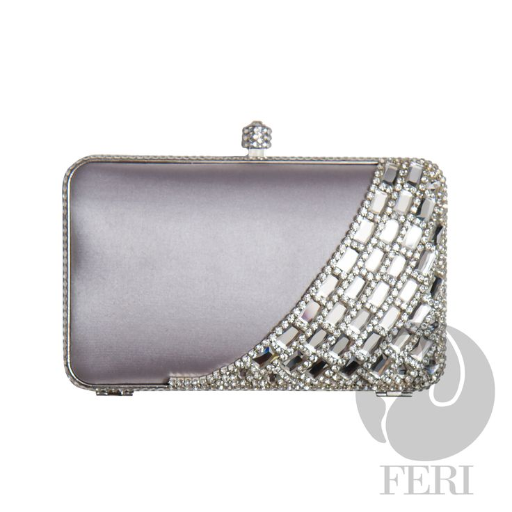 "FERI Day2Day - Kim - Evening Clutch - Silver - Silver satin lined box clutch - Embellished with silver toned metal, white coloured baguette and round stones - Mirror-like facets give amazing colour and shine - Push top locking closure - Comes with silver toned customized FERI  - Custom FERI lining with interior pouch - Dimension: 6.5"" x 3.94"" x 1.26"" (Width x Height x Depth)   www.gwtcorp.com/ghem or email fashionforghem.com for big discount"