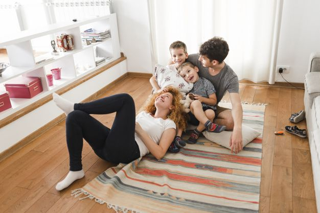 Download Happy Family Hanging Out In Living Room For Free Familia Feliz Fotos De Familia Salas