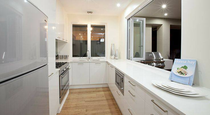 This fresh, modern galley kitchen just invites you to cook! #weeksbuilding #kitchen